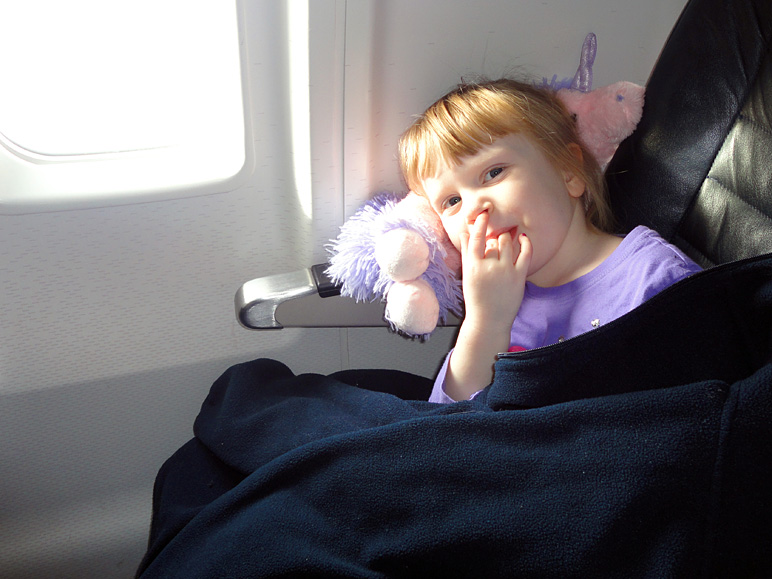 Kate, looking pretty comfy on the plane (153.77 KB)