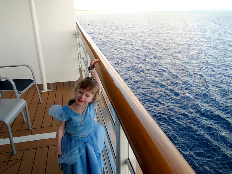 Katelyn, dressed up as Cinderella, on a Disney Dream veranda (241.26 KB)