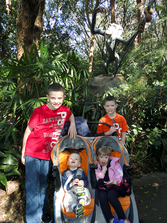 The kids at Animal Kingdom in front of Rafiki (359.69 KB)