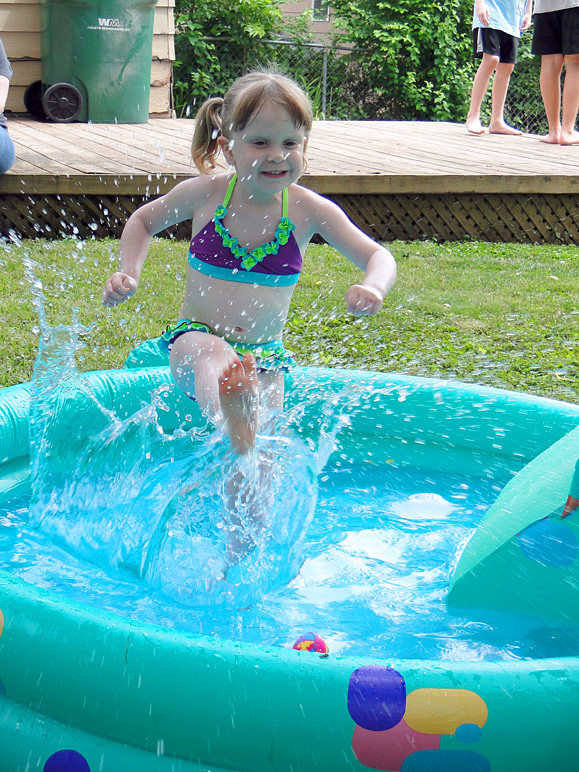 Kate kicking some water in her pool at her birthday party (313.94 KB)